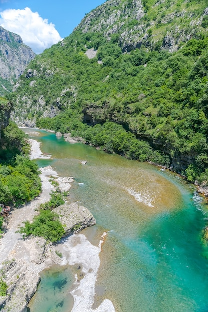 The purest waters of the turquoise color of the river moraca flowing among the canyons. montenegro. Premium Photo