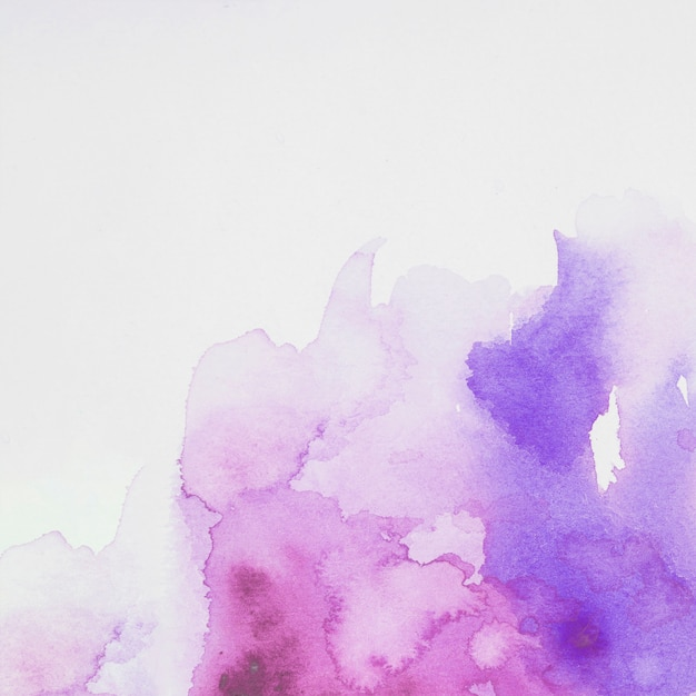 Purple and blue mix of paints on white paper Free Photo