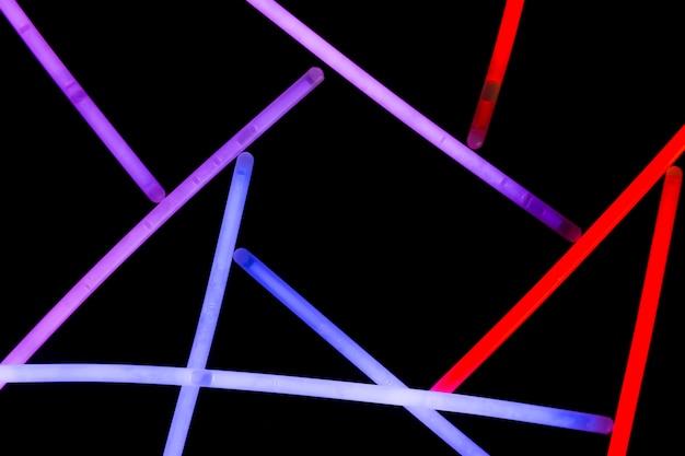 Purple; blue and red neon straws on dark background Free Photo