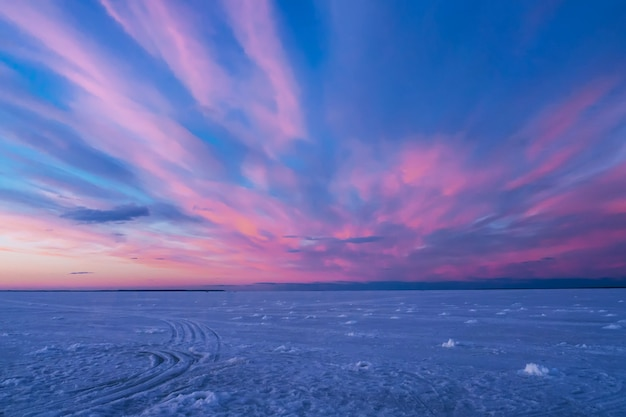 Purple blue sunset or sunrise in winter over the river Premium Photo