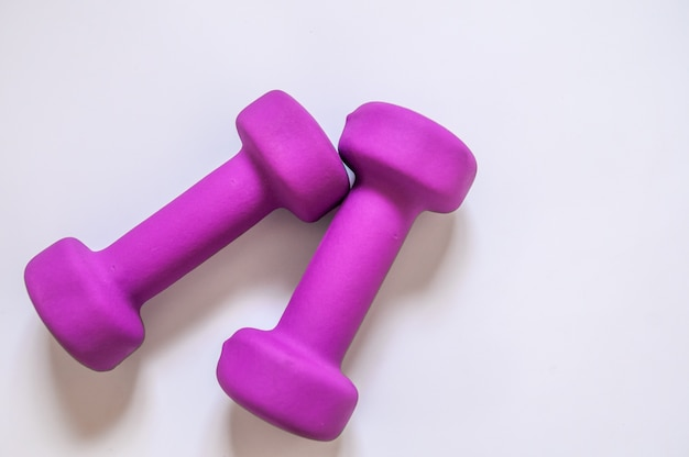 Purple dumbbells, fitness concept isolated on white background, fitness concept isolated on white background, sport, body building. concept healthy lifestyle, sport and diet. sport equipment. copy space Free Photo