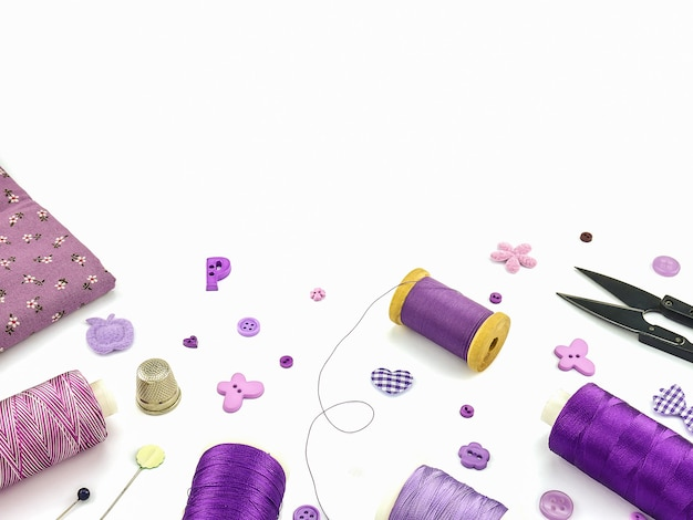 Purple embroidery set over white background Free Photo