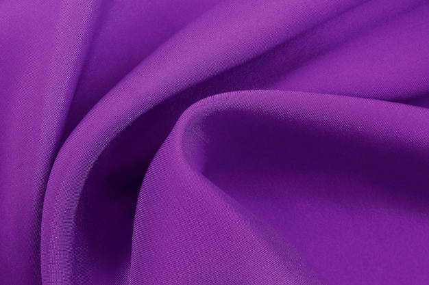 Purple fabric texture for background and design, beautiful pattern of silk or linen. Premium Photo