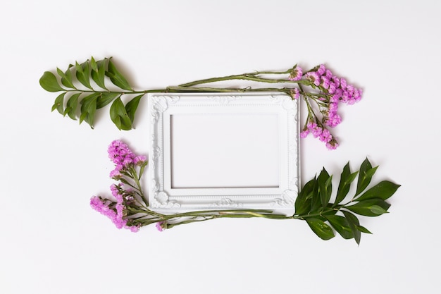 Purple flowers between photo frame Free Photo