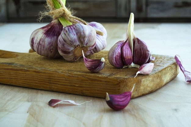 Purple garlic on a wooden board. Premium Photo