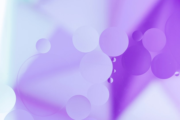 Purple oil drops on pale color surface Free Photo