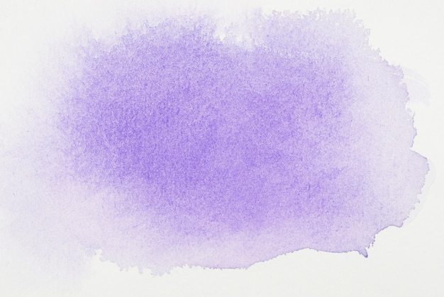 Purple paints on white sheet Premium Photo