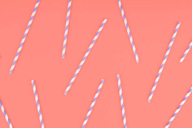 Purple paper straws on orange Premium Photo