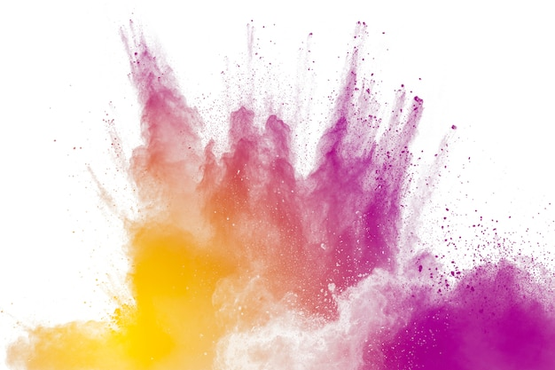 Purple particles explosion on white background. freeze motion of purple dust splash on background. Premium Photo