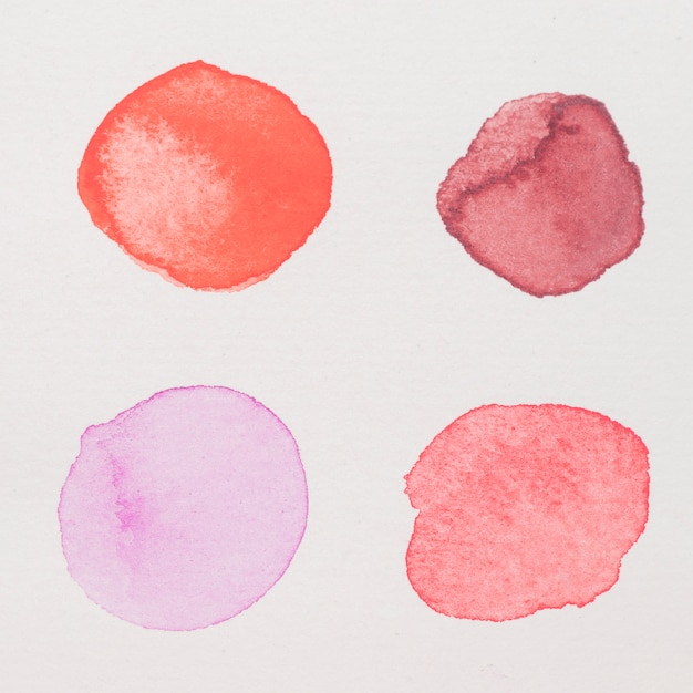 Purple, red,pink andcrimson paints on white paper Free Photo