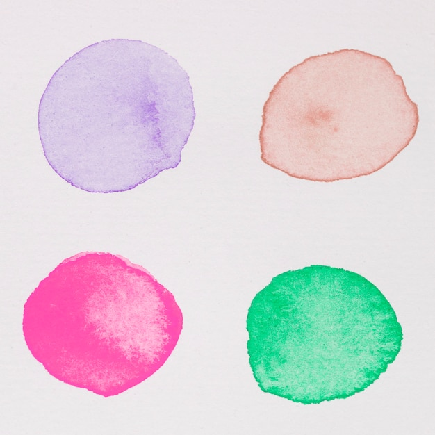 Purple, red, pink and green paints on white paper Free Photo
