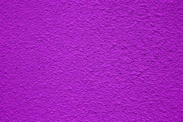 A purple rough background or texture for use in construction or banners Premium Photo