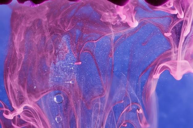 Purple smoke with sparkling bubbles Free Photo