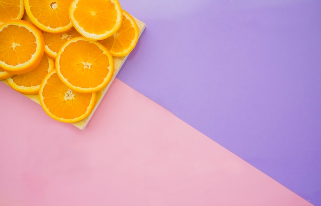 Purple surface with tasty orange slices Free Photo