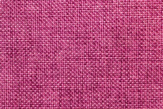 Purple textile background closeup. structure of the fabric macro Premium Photo