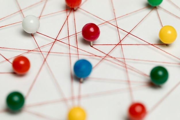 Pushpin tracks and thread close-up Free Photo