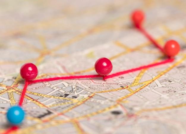 Pushpins route on vintage map Premium Photo