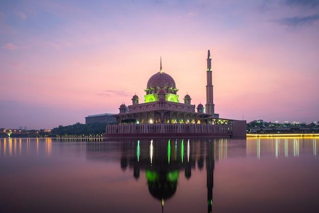 Putrajaya mosque or pink mosque with lake between sunrise in kuala lumpur Premium Photo