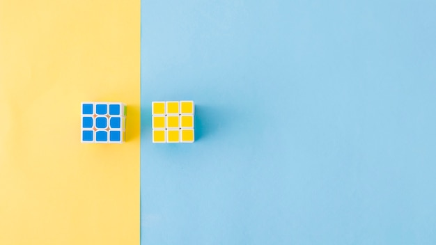 Puzzle cubes laying in composition Premium Photo