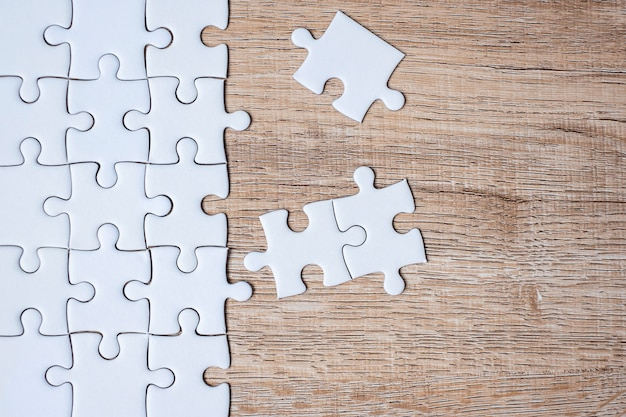 Puzzle pieces on wood table. business solutions, mission target Premium Photo