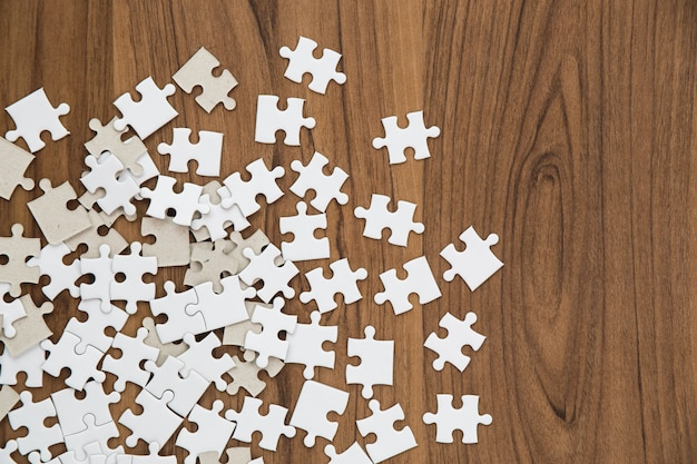 Puzzle Pieces On Wooden Table Photo Free Download