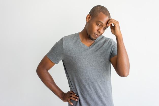 Puzzled handsome african man having problems. Free Photo