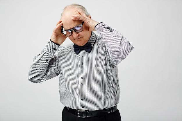 Puzzled senior man Free Photo