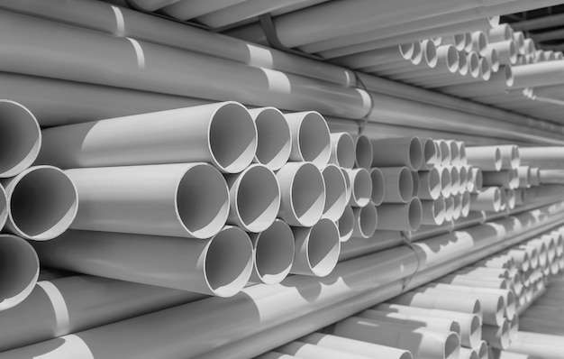 Pvc pipe stacked in warehouse Premium Photo