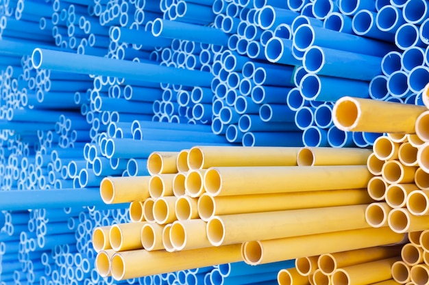 Pvc pipes for electric conduit (yellow) and water (blue) Premium Photo