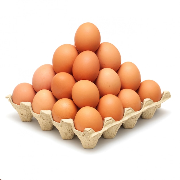 Pyramid of brown eggs isolated on white Premium Photo