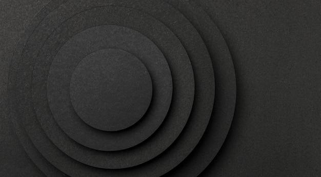 Пирамида из круглых кусочков черной бумаги копией пространства Premium Фотографии