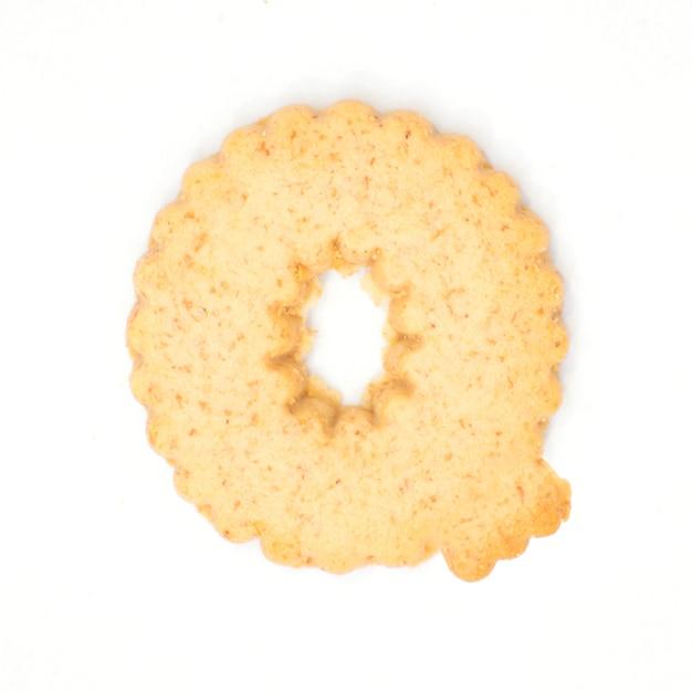 Буква q из печенья взломщика на белом фоне Premium Фотографии
