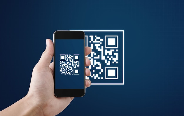 Qr code scanning payment and verification. hand using mobile  phone scan qr code Premium Photo