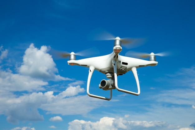Quadrocopter is flying high in the sky Premium Photo