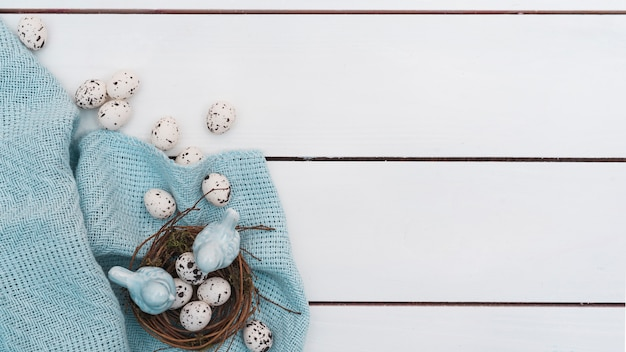 Quail eggs in nest on wooden table Free Photo