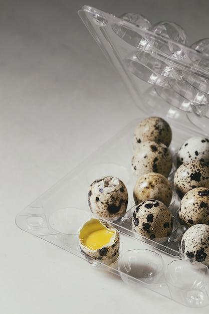 Quail eggs in plastic boxing Premium Photo