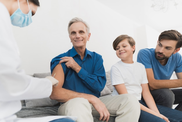 Qualified doctor injects insulin to elderly man. Premium Photo