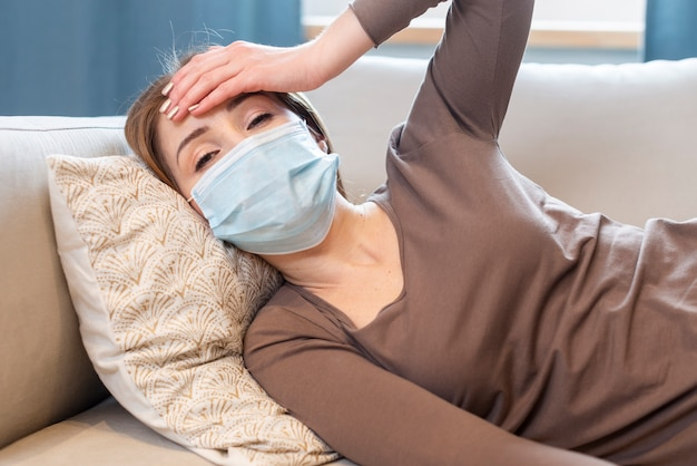 Quarantine daily activities and woman laying on couch Free Photo