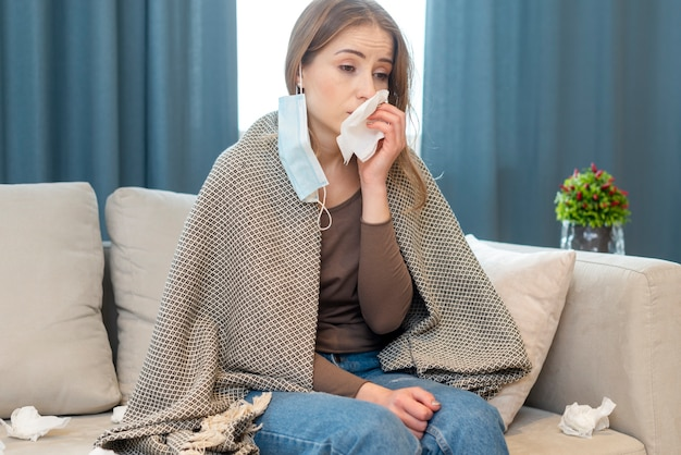 Quarantine daily activities and woman with runny nose Free Photo