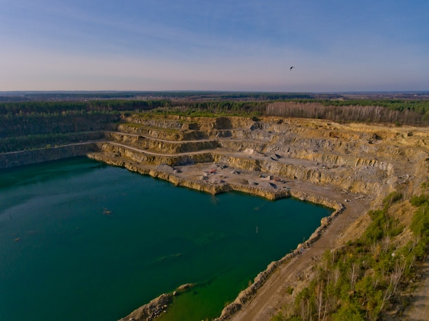 The quarry after the mining of minerals is filled with water. aerial view. Premium Photo