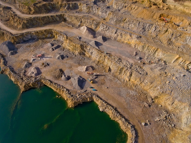 The quarry after the mining of minerals is filled with water. technique extracts minerals. aerial view. Premium Photo