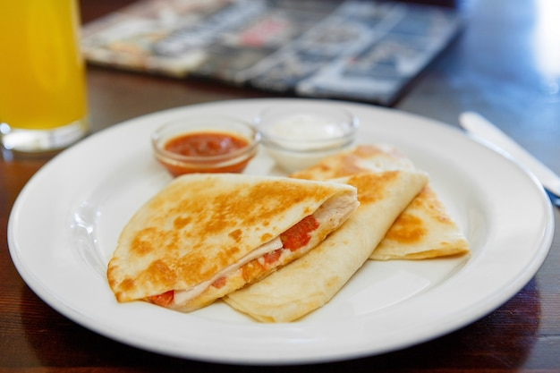 Quesadilla with chicken and tomatoes, two sauce Premium Photo