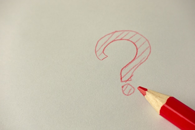 Question mark with red graphite pencil Premium Photo