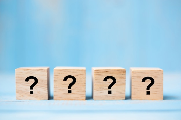 Questions mark on wooden cube block Premium Photo