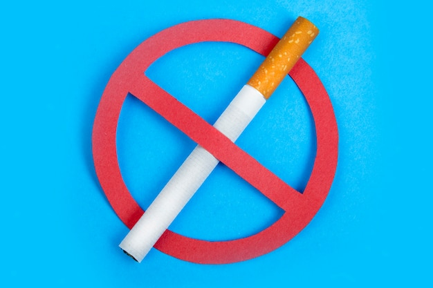 Quitting smoking. stop smoking  on blue. healthy life Premium Photo