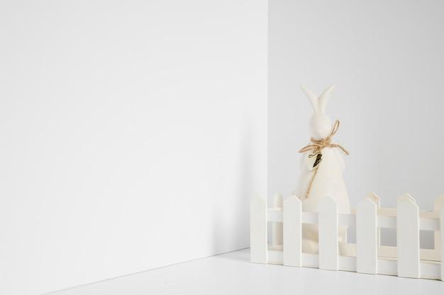 Rabbit figurine at fence Free Photo