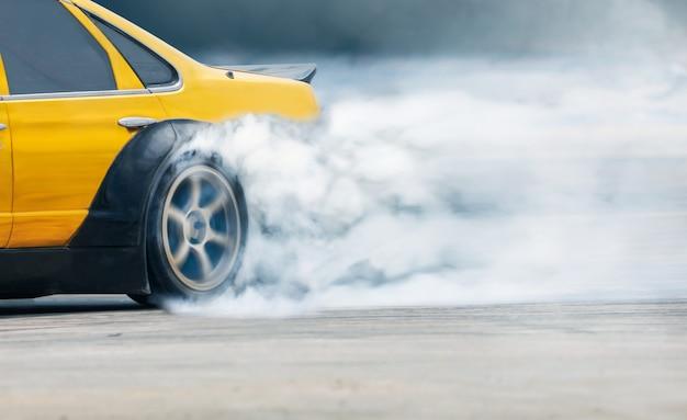 Race drift car burning tires on speed track Premium Photo