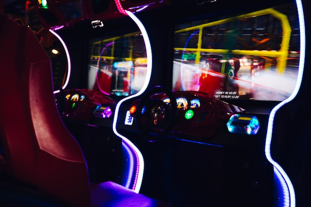 Racing arcade game with neon lights Free Photo
