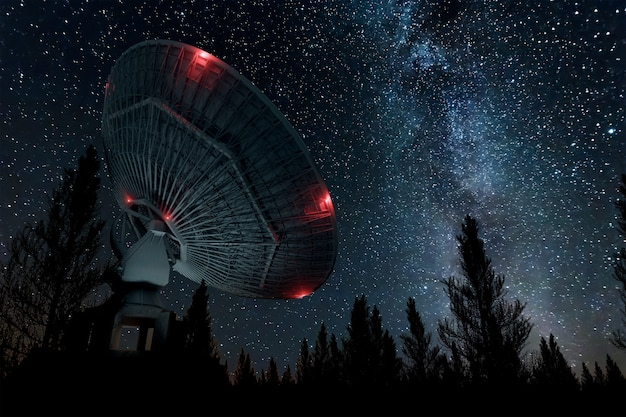 Radio telescope, a large satellite dish against the night sky tracks the stars. technology concept, search for extraterrestrial life, wiretap of space. mixed medium, copy space. Premium Photo