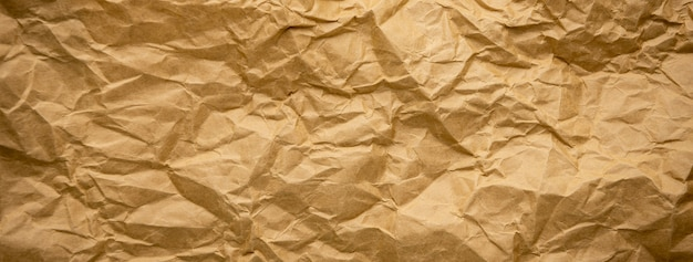Ragged crumpled brown kraft paper texture banner background Premium Photo